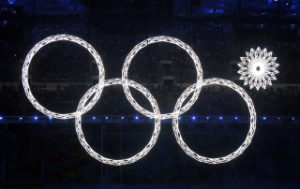 Four of five Olympic Rings are seen lit up during the opening ceremony of the 2014 Sochi Winter Olympics